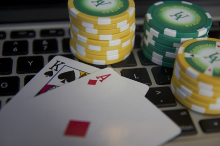 Researchers at the University of Alberta have built a robot that has 'solved' the game of heads up limit Texas hold'em poker. Photo credit: Michael Bowling